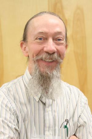 SCC faculty member pens glass program's history